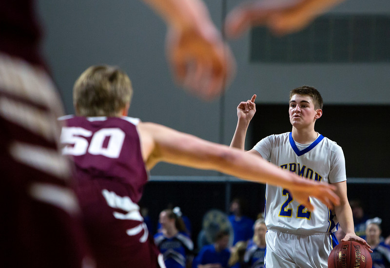 BANGOR, Maine -- 02/22/2017 -- Hermon's Cody Hawes (center) calls out the play during their Class B boys basketball semifinal game against Orono's Keenan Collett at the Cross Insurance Center in Bangor Wednesday. Ashley L. Conti   BDN
