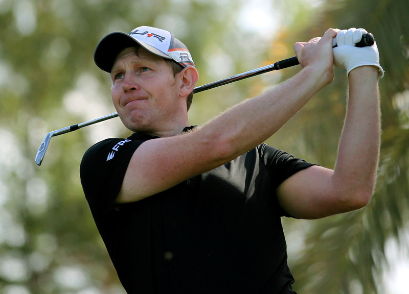 . Stephen Gallacher of Scotland follows his ball on the 15th hole during the final round of the Dubai Desert Classic Golf tournament in Dubai, United Arab Emirates, Sunday, Feb. 3, 2013. (AP Photo/Kaveh Kashani)