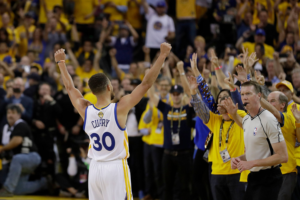 . Golden State Warriors guard Stephen Curry (30) celebrates with fans after Game 5 of basketball\'s NBA Finals between the Warriors and the Cleveland Cavaliers in Oakland, Calif., Monday, June 12, 2017. The Warriors won 129-120 to win the NBA championship. (AP Photo/Marcio Jose Sanchez)