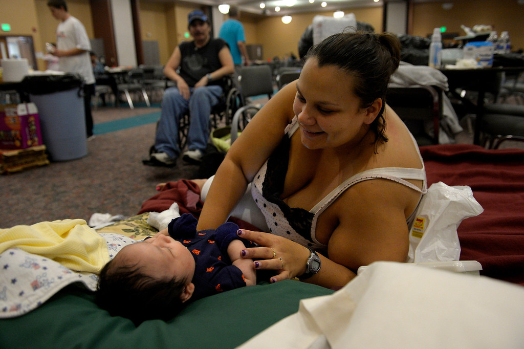 . Melinda Villa plays with her son 1 month old Ezra as rescued residents of Lyons are being sheltered at the LifeBridge Christian Church in Longmont September 13, 2013 Longmont, Colorado. (Photo By Joe Amon/The Denver Post)
