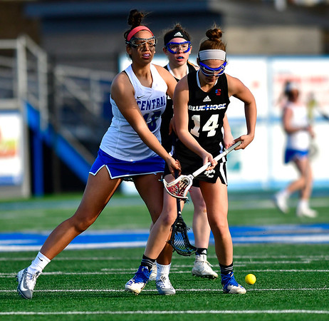 3/14/2019 Mike Orazzi | Staff CCSU's Raphaela DaSilva (16) and Presbyterian College's Megan Dreyer (14)during Thursday's women's lacrosse in New Britain.