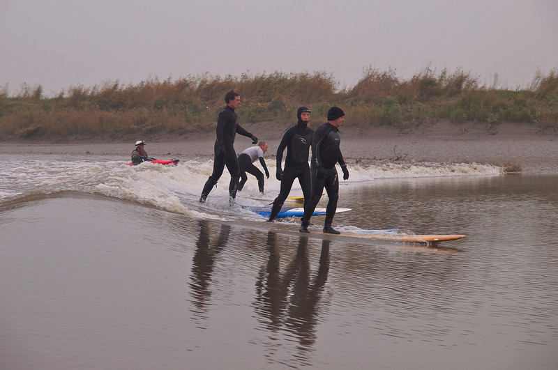 Nice action shot of the surfers riding the bore.