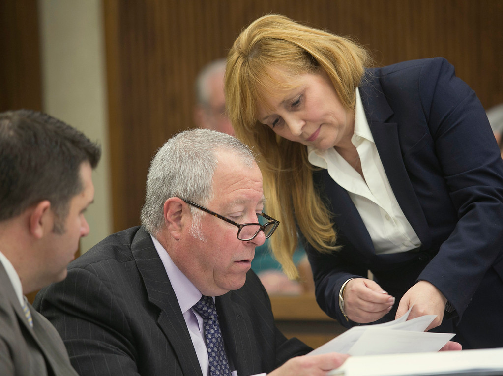 . Michael Allen Blair/MBlair@News-Herald.com Prosecutor Lisa Neroda presents a document to defense attorney Michael J. Connick on day three of Kevin Knoefel\'s murder conspiracy trial in Lake County Common Pleas Court on June 4, 2014.