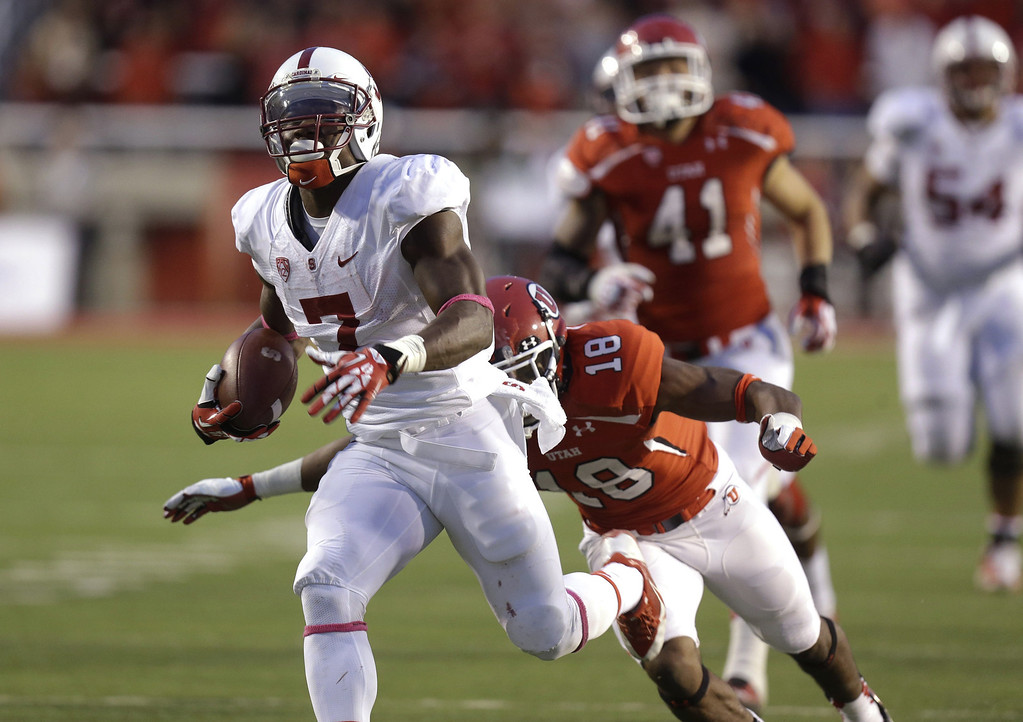 . Stanford wide receiver Ty Montgomery (7) carries the ball as Utah defensive back Eric Rowe (18) makes a diving tackle during the second half of an NCAA college football game on Saturday, Oct. 12, 2013, in Salt Lake City. Utah won 27-21. (AP Photo/Rick Bowmer)