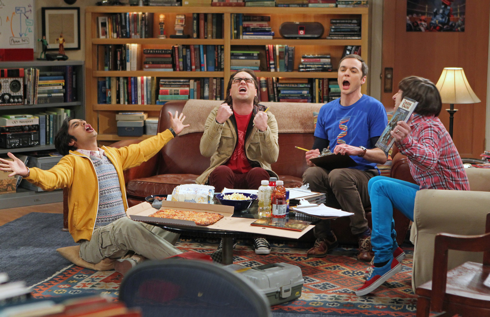 ". This publicity image released by CBS shows, from left,  Kunal Nayyar, Johnny Galecki, Jim Parsons and Simon Helberg in a scene from ""The Big Bang Theaory.\""  The program was nominated for an Emmy Award for outstanding comedy series on, Thursday July 18, 2013. The Academy of Television Arts & Sciences\' Emmy ceremony will be hosted by Neil Patrick Harris. It will air Sept. 22 on CBS. (AP Photo/CBS, Monty Brinton)"