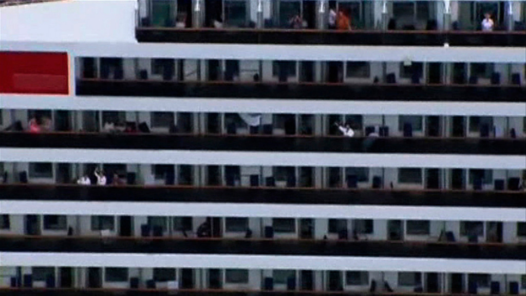. People wave on their balconies on the cruise ship Carnival Triumph cruise ship in this video frame grab from NBC News taken off the coast of Alabama February 14, 2013.  REUTERS/NBC News/Handout