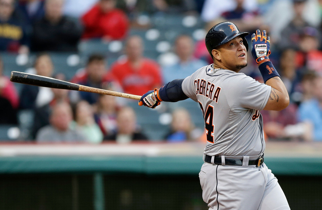 . Detroit Tigers\' Miguel Cabrera hits a double off Cleveland Indians starting pitcher Corey Kluber in the third inning of a baseball game, Monday, May 19, 2014, in Cleveland. (AP Photo/Tony Dejak)