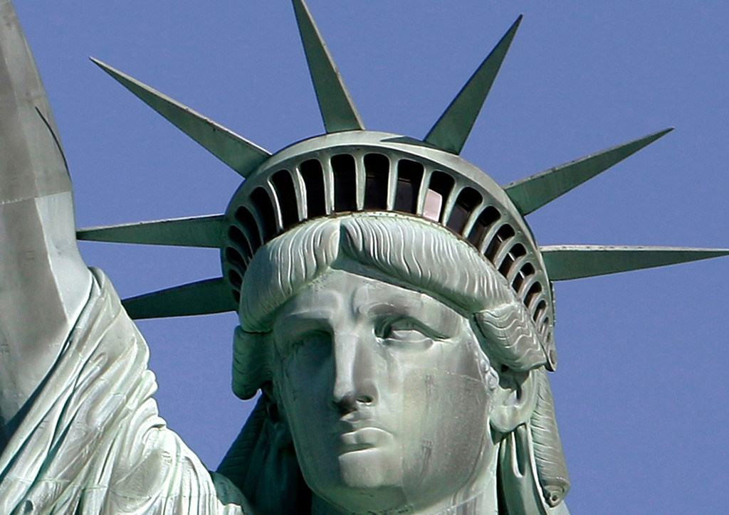 . FILE - This May 20, 2009 file photo shows the Statue of Liberty  in New York Harbor.  Statue of Liberty arrived in U.S. 130 years ago today. (AP Photo/Richard Drew, File)