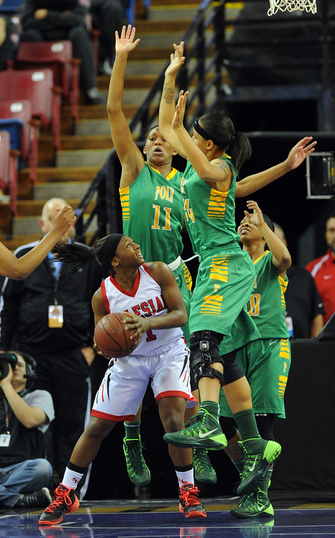 . Poly\'s Lajahna Drummer and Emoni Jackson guard Salesian\'s Kian McNair at Sleep Train Arena in Sacramento, CA on Saturday, March 29, 2014. Long Beach Poly vs Salesian in the CIF Open Div girls basketball state final. 1st half. (Photo by Scott Varley, Daily Breeze)
