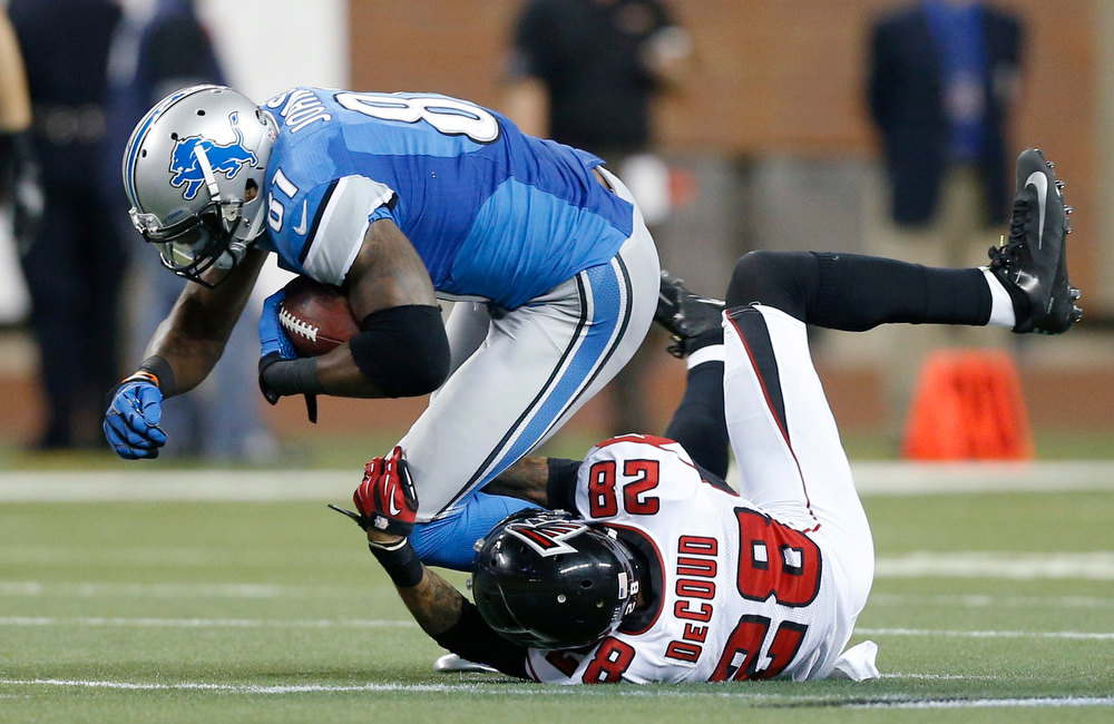 Description of . Detroit Lions wide receiver Calvin Johnson (81) is stopped by Atlanta Falcons free safety Thomas DeCoud (28) during the second quarter of an NFL football game at Ford Field in Detroit, Saturday, Dec. 22, 2012. (AP Photo/Rick Osentoski)