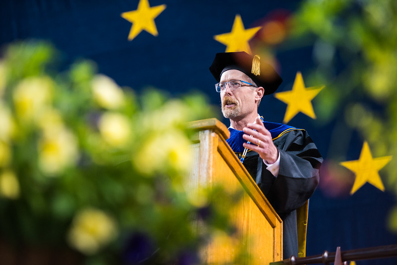 UAF Chancellor Daniel M. White welcomes graduates at the start of the 2018 commencement ceremony at the Carlson Center on May 5, 2018.