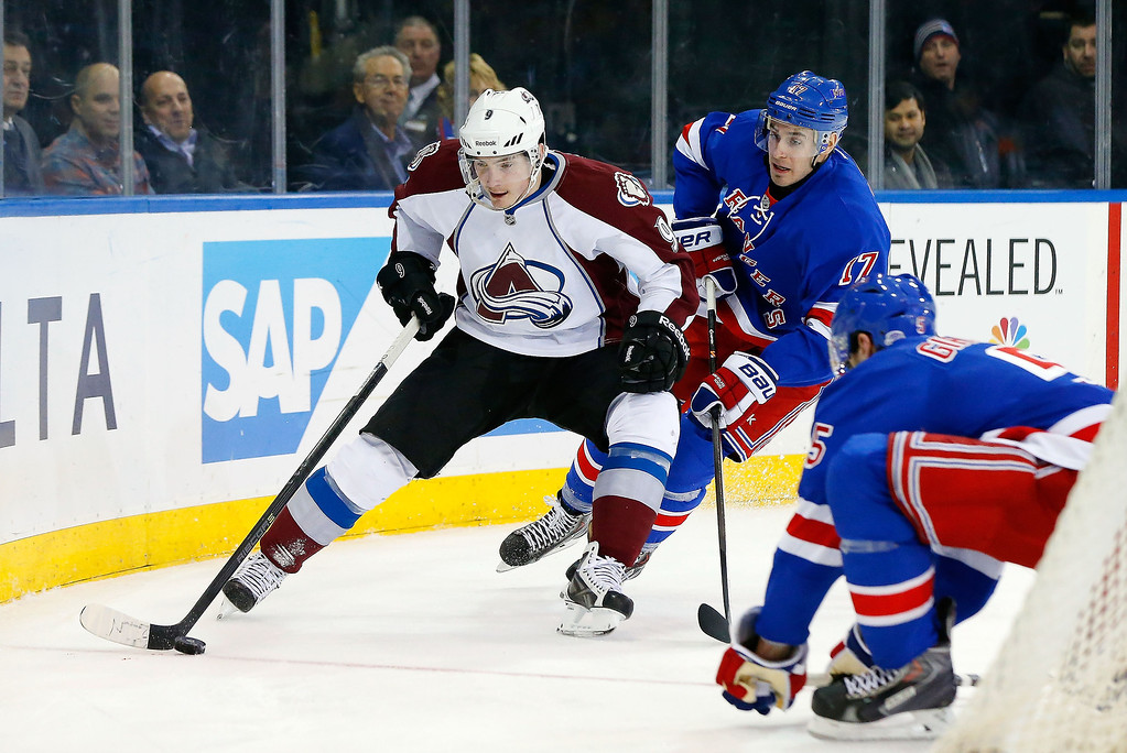 . Matt Duchene #9 of the Colorado Avalanche carries the puck behind the net during the first period against John Moore #17 of the New York Rangers at Madison Square Garden on February 4, 2014 in New York City.  (Photo by Jim McIsaac/Getty Images)