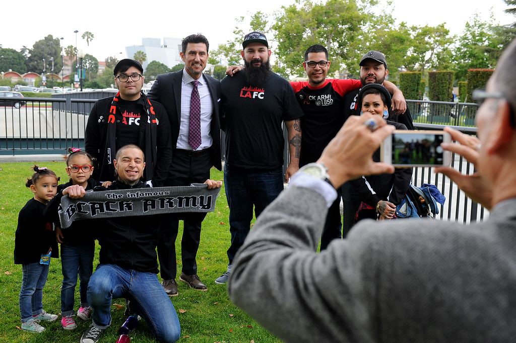 . Nomar Garciaparra, standing second from left, takes a picture with soccer fans before the announcement of Los Angeles Football Club\'s intent to build a new soccer stadium at the site of the L.A. Sports Arena, Monday, May 18, 2015. (Photo by Michael Owen Baker/Los Angeles Daily News)