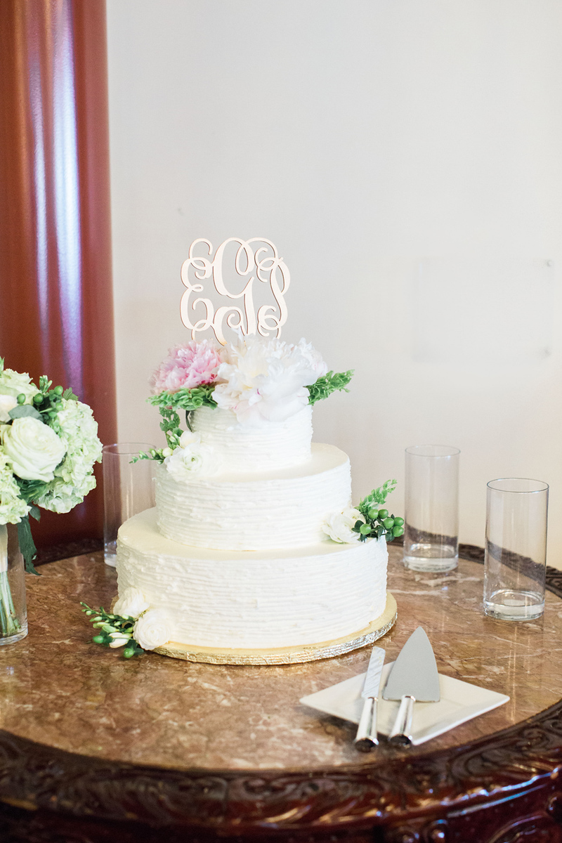 White ruffle cake with gold monogram topper. 1840s Plaza wedding reception photos from Erin and Patrick's wedding. The Baltimore area Catholic wedding ceremony was at The Church of the Immaculate Conception in Towson, MD. This was a 1840s Plaza wedding reception. The best Baltimore wedding photographer was Jalapeno Photography.