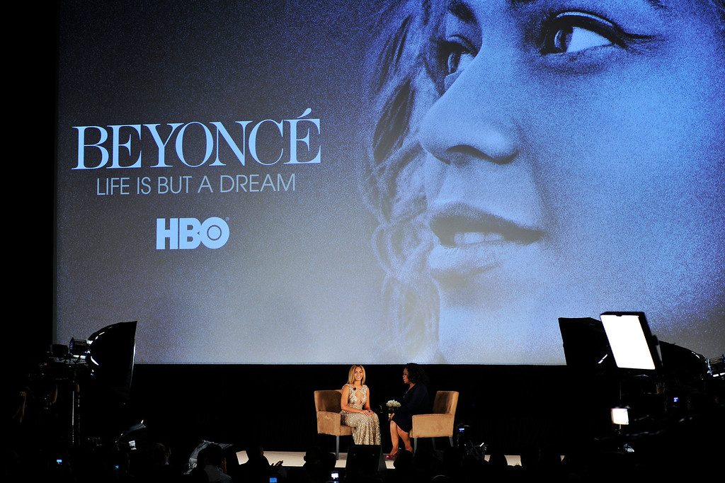 ". NEW YORK, NY - FEBRUARY 12:  Beyonce and Oprah Winfrey speak onstage at the HBO Documentary Film ""Beyonce: Life Is But A Dream\"" New York Premiere at the Ziegfeld Theater on February 12, 2013 in New York City.  (Photo by Larry Busacca/Getty Images for Parkwood Entertainment)"