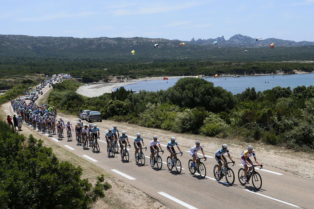 . The pack rides during the 213 km first stage of the 100th edition of the Tour de France cycling race on June 29, 2013 between Porto-Vecchio and Bastia, on the French Mediterranean Island of Corsica.  AFP PHOTO / PASCAL  GUYOT/AFP/Getty Images