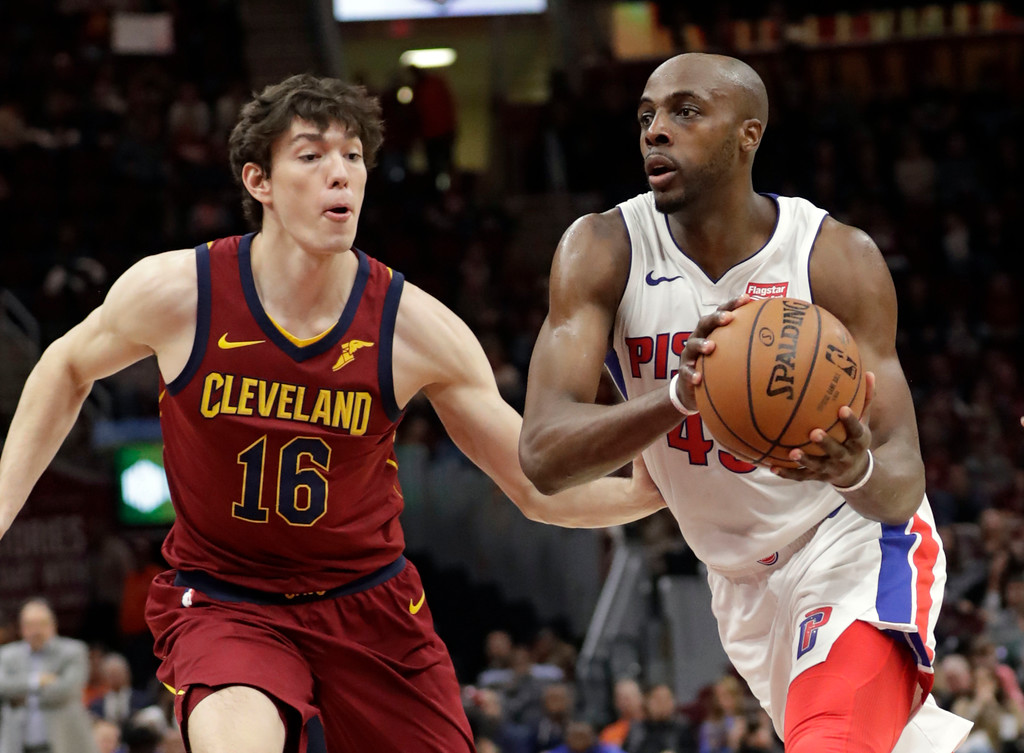 . Detroit Pistons\' Anthony Tolliver, right, drives past Cleveland Cavaliers\' Cedi Osman, from Turkey, in the second half of an NBA basketball game, Sunday, Jan. 28, 2018, in Cleveland. The Cavaliers won 121-104. (AP Photo/Tony Dejak)