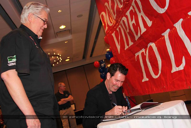 Mark Trostle autographs Jon B's book for him.