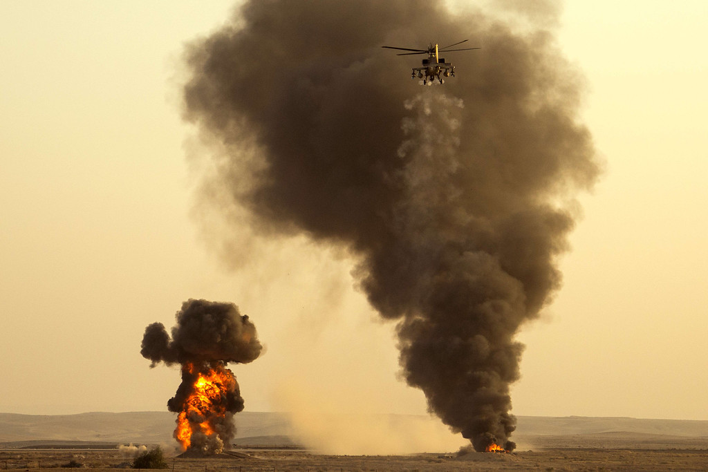 . An Israel Boeing AH-64 Apache longbow helicopter performs during an air show at the graduation ceremony of Israeli air force pilots at the Hatzerim base in the Negev desert, near the southern Israeli city of Beersheva on December 26, 2013. AFP PHOTO/JACK GUEZ/AFP/Getty Images