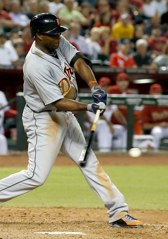 . Detroit Tigers\' Torii Hunter connects for a two-run single against the Arizona Diamondbacks during the eighth inning of a baseball game on Tuesday, July 22, 2014, in Phoenix. (AP Photo)