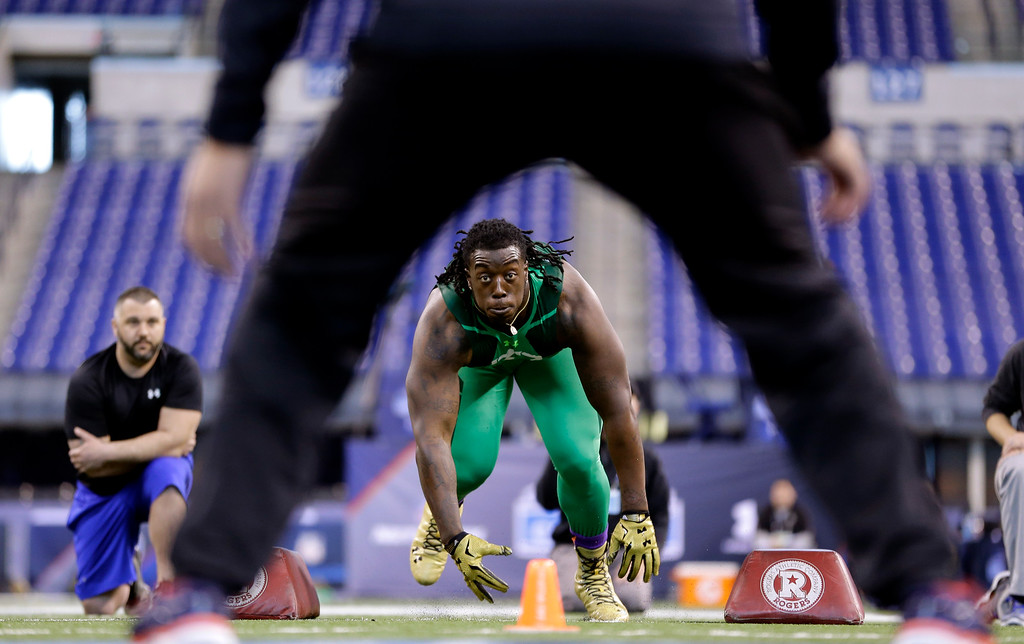 . Southern Mississippi defensive lineman Rakeem Nunez-Roches runs a drill at the NFL football scouting combine in Indianapolis, Sunday, Feb. 22, 2015. (AP Photo/Julio Cortez)