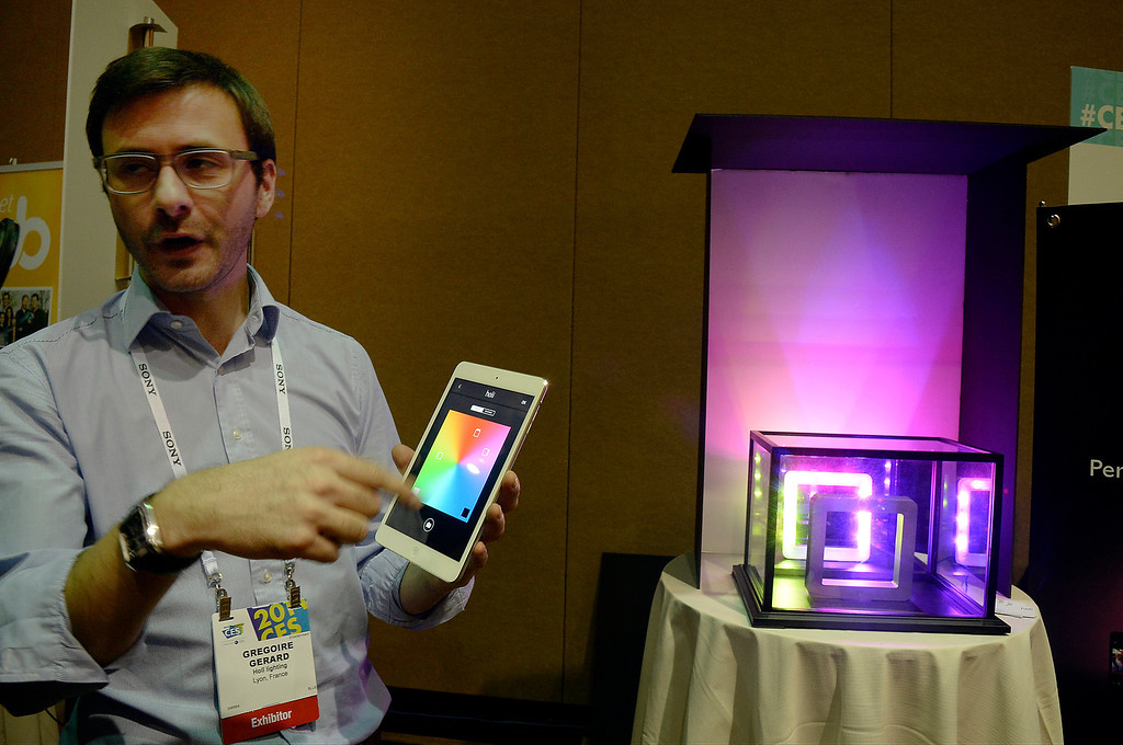 . Gregoire Gerard with Holt Lightning displays the new iPhone control lamp during the 2014 Consumer Electronics Show (CES) on Sunday, June 5, 2014 in Las Vegas, Nevada. The 2014 CES show starts Tuesday, Jan. 7, 2014 and runs until Friday, Jan. 10, 2014 with 150,000 people estimated to attend the show. (Photo by Gene Blevins/Los Angeles Daily News)