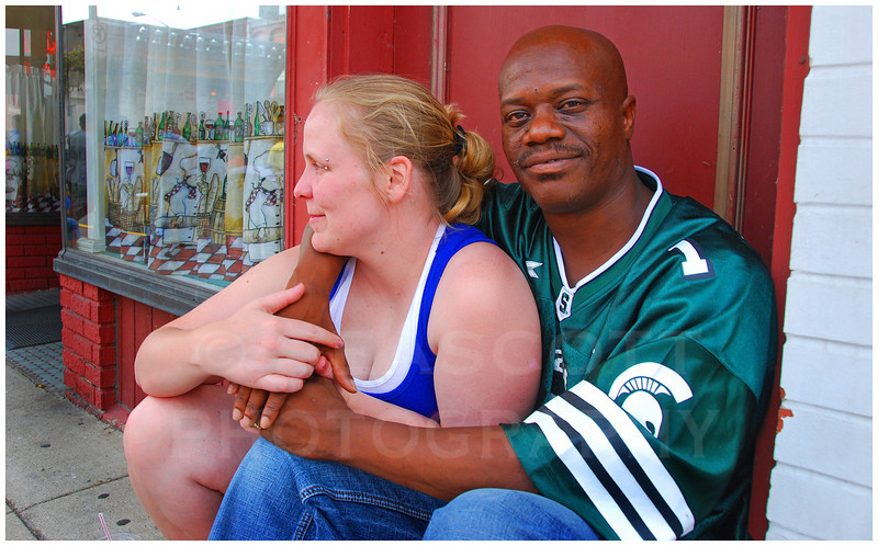 A couple attends a street fair in Three Rivers, Michigan.