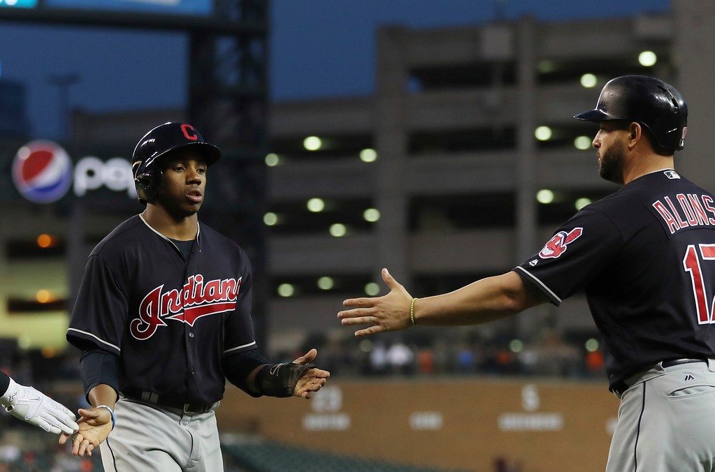 . Cleveland Indians\' Greg Allen is congratulated by Yonder Alonso after they both scored during the sixth inning of a baseball game against the Detroit Tigers, Tuesday, May 15, 2018, in Detroit. (AP Photo/Carlos Osorio)