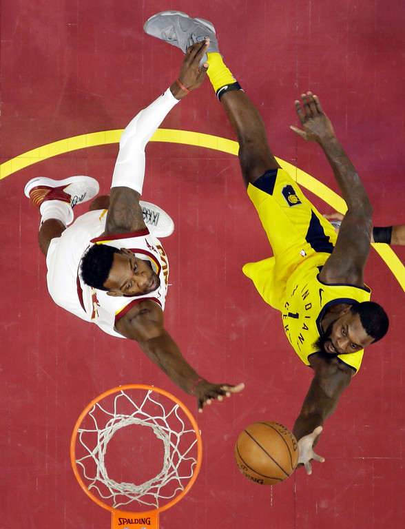 . Indiana Pacers\' Lance Stephenson, right, drives to the basket against Cleveland Cavaliers\' Jeff Green during the second half of an NBA basketball game Friday, Jan. 26, 2018, in Cleveland. The Cavaliers won 115-108. (AP Photo/Tony Dejak)