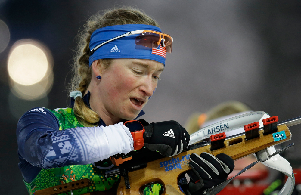 . United States\' Hannah Dreissigacker reloads during the women\'s biathlon 4x6k relay at the 2014 Winter Olympics, Friday, Feb. 21, 2014, in Krasnaya Polyana, Russia. (AP Photo/Kirsty Wigglesworth)