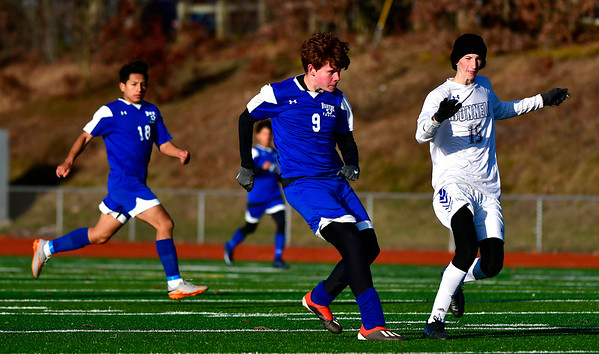 11/13/2019 Mike Orazzi | StaffrBristol Eastern's Dominik Femiak (9) during the Class L Second Round boys soccer tournament with Bunnell High School in Bristol on Wednesday.