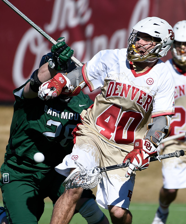 . DENVER, CO - FEBRUARY 28: Denver Connor Cannizzaro (40) delivers an underhand pass as Dartmouth Max Randall (28) pressures him during the Face-off Classic February 28, 2016 at Peter Barton Lacrosse Stadium. (Photo By John Leyba/The Denver Post)
