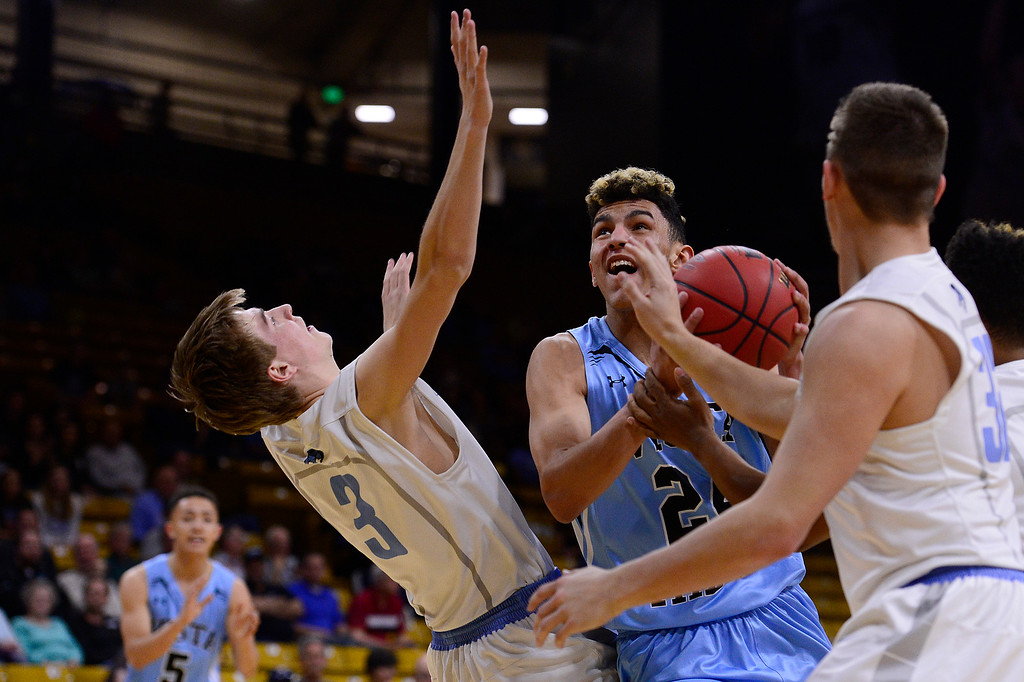 . Hunter Maldonado (24) of Vista Ridge charges Braden Shirley (3) of Pueblo West while going for a shot during the first quarter at the Coors Events Center on March 11, 2016 in Boulder, Colorado. (Photo by Brent Lewis/The Denver Post)
