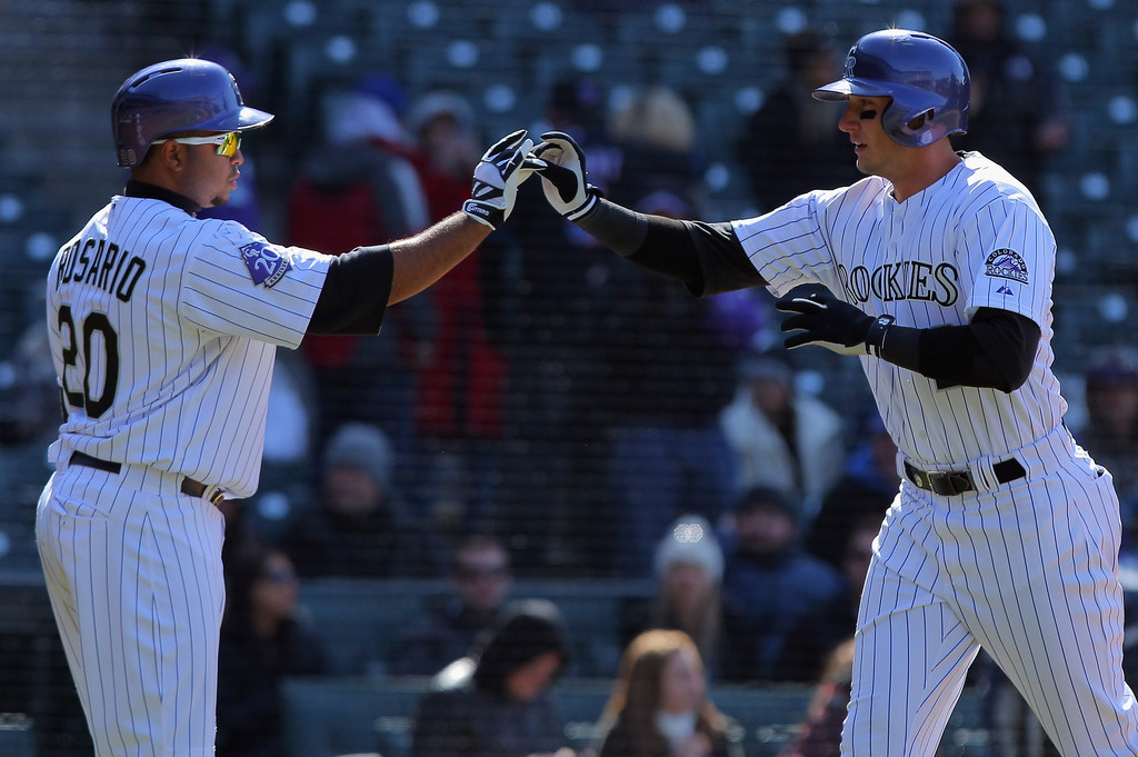 . Troy Tulowitzki #2 of the Colorado Rockies celebrates his solo homerun off of Jeremy Hefner #53 of the New York Mets with Wilin Rosario #20 of the Colorado Rockies in the eighth inning at Coors Field on April 18, 2013 in Denver, Colorado.  (Photo by Doug Pensinger/Getty Images)