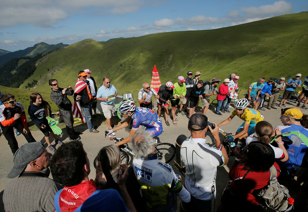 . Italy\'s Vincenzo Nibali, wearing the overall leader\'s yellow jersey, follows France\'s Thibaut Pinot, left, as they climb Port de Bales pass during the sixteenth stage of the Tour de France cycling race over 237.5 kilometers (147.6 miles) with start in Carcassonne and finish in Bagneres-de-Luchon, France, Tuesday, July 22, 2014. (AP Photo/Christophe Ena)
