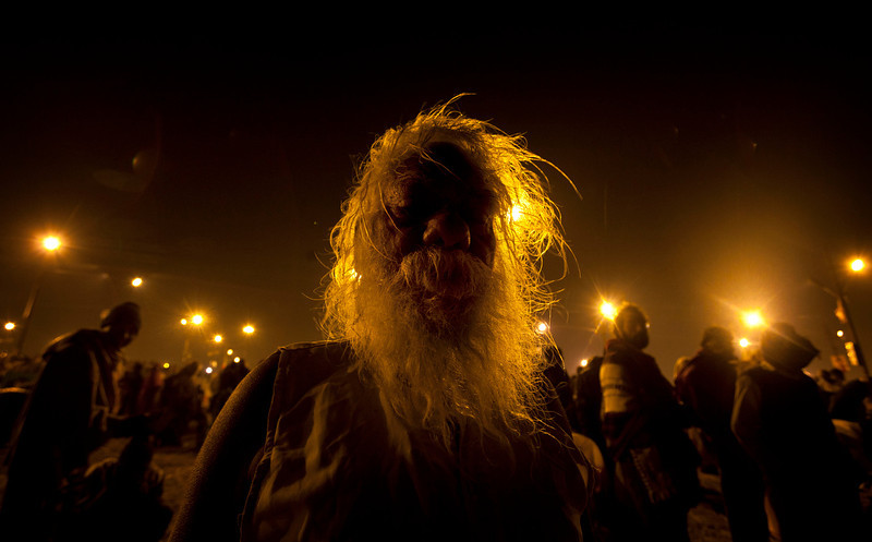". A Hindu devotee waits for his companion after a holy bath at ""Sangam,\"" the meeting point of Indian holy rivers of Ganges, Yamuna and the mythical Saraswati, on occasion of \""Paush Purnima,\"" considered to be very auspicious according to Hindu calendars, during the Maha Kumbh festival in Allahabad, India, Sunday, Jan. 27, 2013. Hundreds of thousands of Hindu pilgrims are expected to take a ritual dip at Sangam on Sunday. Millions of Hindu pilgrims are likely to attend the Maha Kumbh festival, which is one of the world\'s largest religious gatherings that lasts 55 days and falls every 12 years. (AP Photo/Rajesh Kumar Singh)"