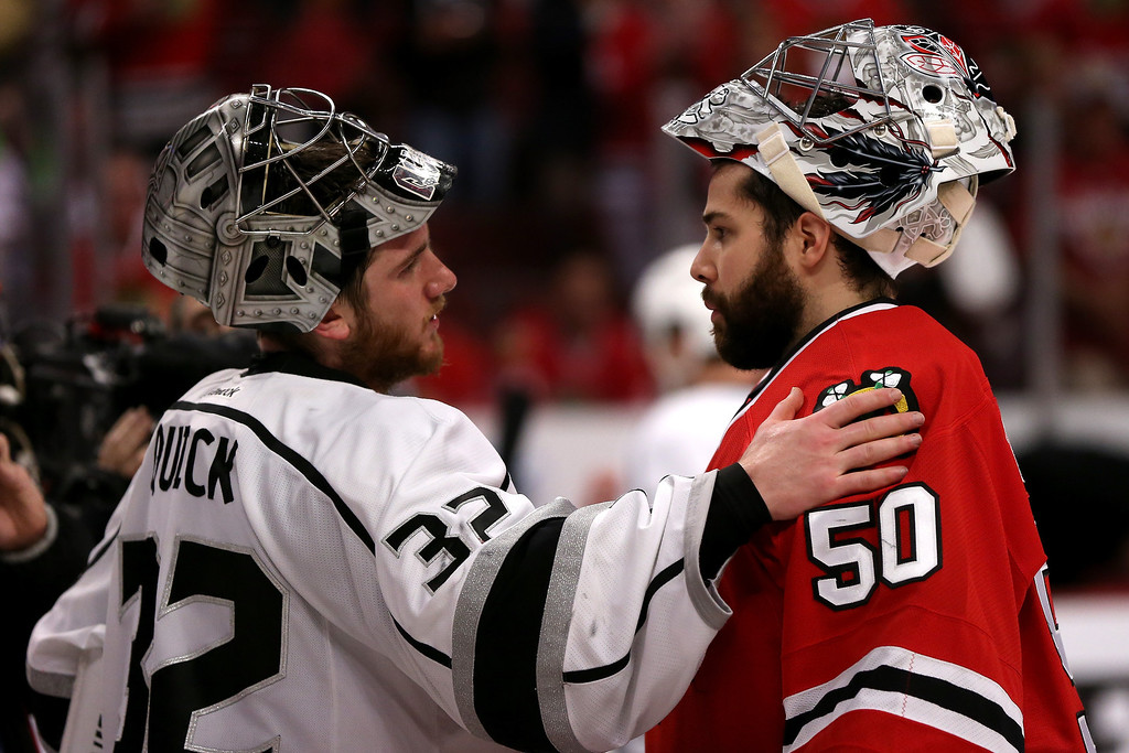 . Jonathan Quick #32 of the Los Angeles Kings talks with Corey Crawford #50 of the Chicago Blackhawks after defeating the Blackhawks 5 to 4 in overtime of Game Seven to win the Western Conference Final in the 2014 Stanley Cup Playoffs at United Center on June 1, 2014 in Chicago, Illinois.  (Photo by Jonathan Daniel/Getty Images)