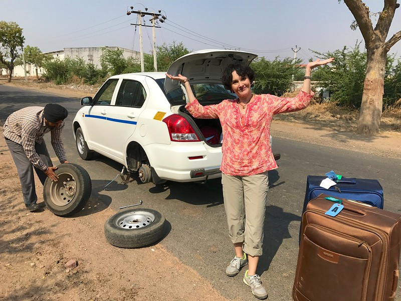 After nearly 1,000 miles and just outside the last stop of our trip, Jodhpur, we have our first snafu! OH NO! A flat tire!