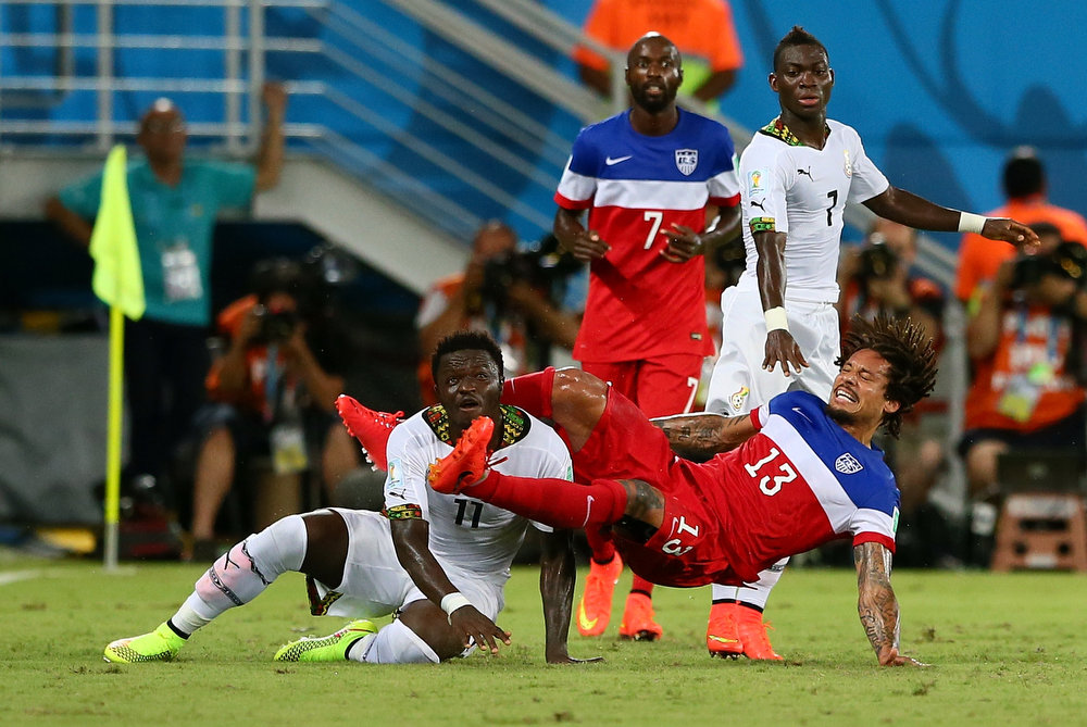 Description of . Jermaine Jones of the United States challenges Daniel Opare of Ghanaduring the 2014 FIFA World Cup Brazil Group G match between Ghana and the United States at Estadio das Dunas on June 16, 2014 in Natal, Brazil.  (Photo by Kevin C. Cox/Getty Images)