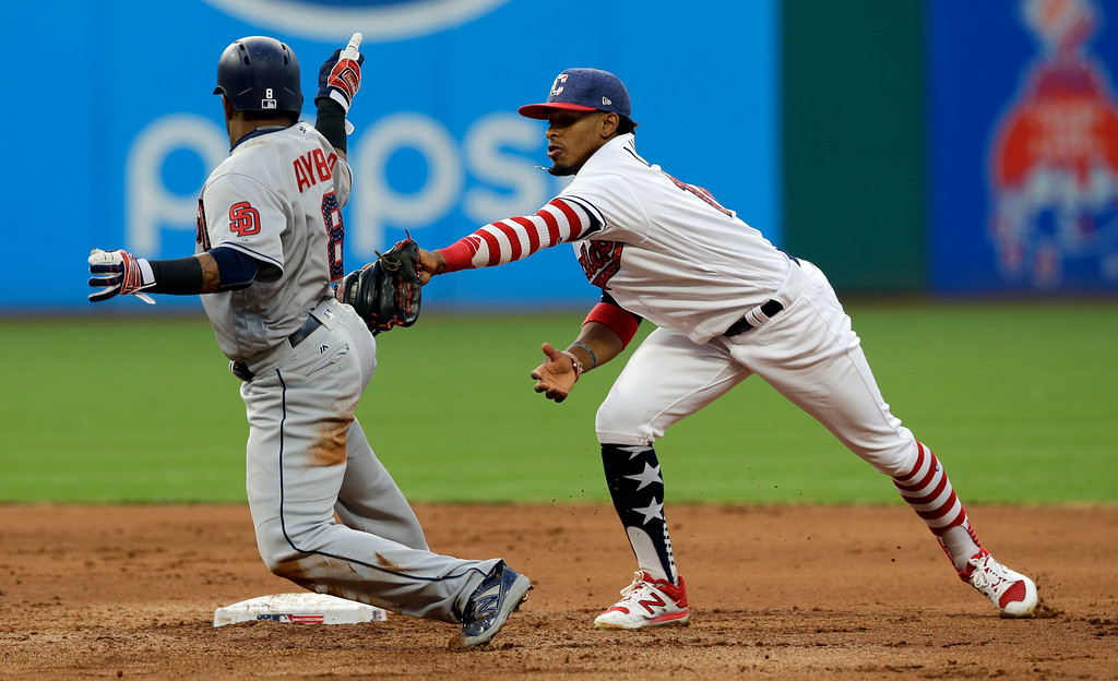 . Cleveland Indians\' Francisco Lindor tags out San Diego Padres\' Erick Aybar at second base in the fifth inning of a baseball game, Tuesday, July 4, 2017, in Cleveland. (AP Photo/Tony Dejak)