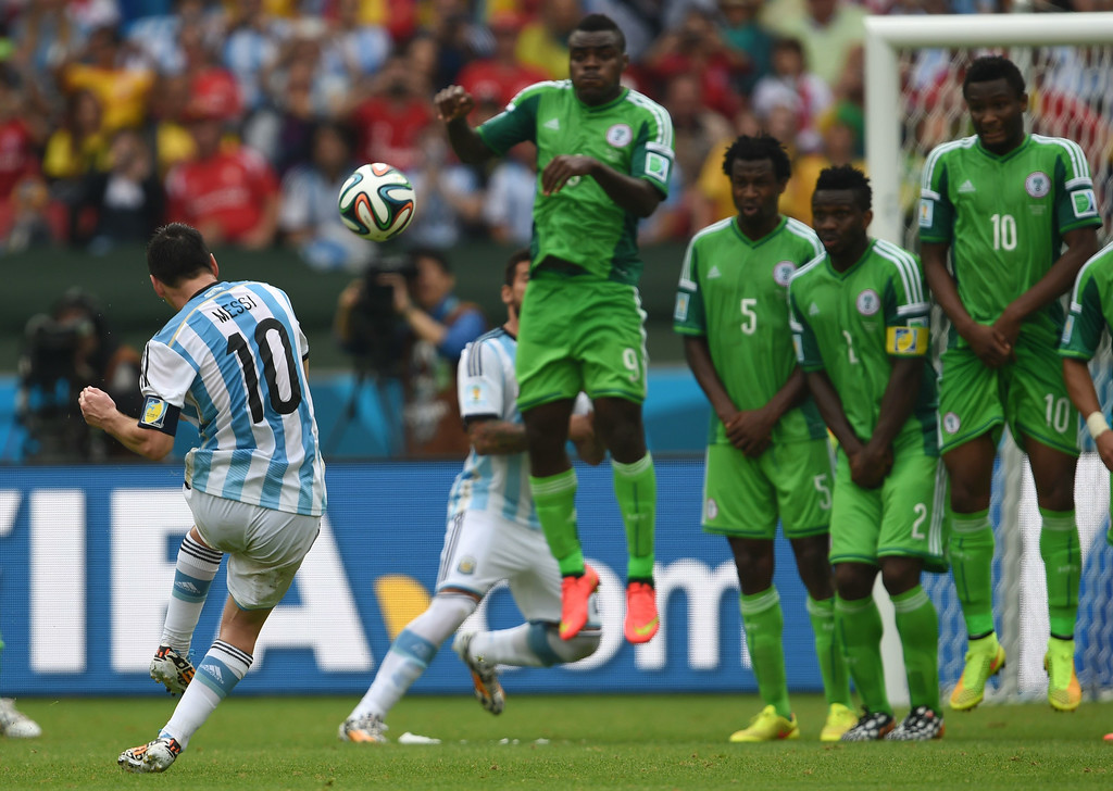 . Argentina\'s forward Lionel Messi shoots to score his second goal, during a Group F football match between Nigeria and Argentina at the Beira-Rio Stadium in Porto Alegre during the 2014 FIFA World Cup on June 25, 2014.  PEDRO UGARTE/AFP/Getty Images
