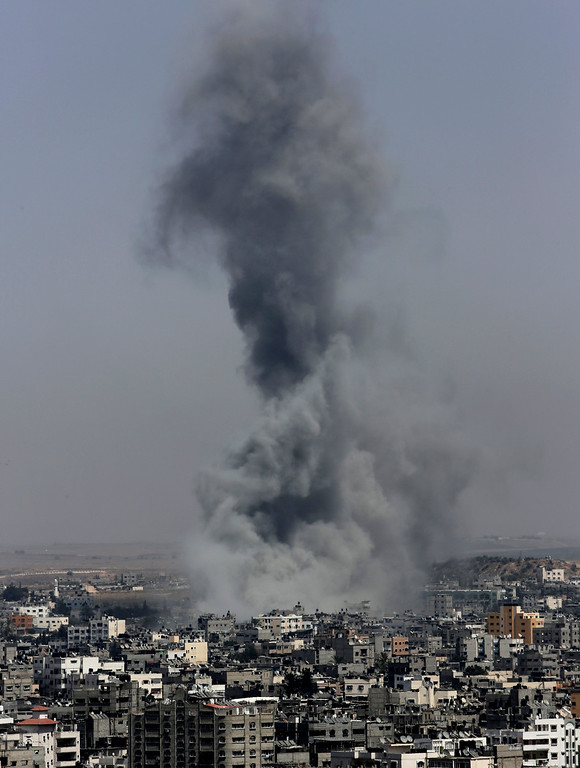 . Smoke from Israeli strikes rise over Gaza City, in the northern Gaza Strip, in the northern Gaza Strip, Wednesday, July 30, 2014. On Wednesday, Israeli aircraft struck dozens of Gaza sites, including five mosques it said were being used by militants, while several other areas came under tank fire.(AP Photo/Adel Hana)