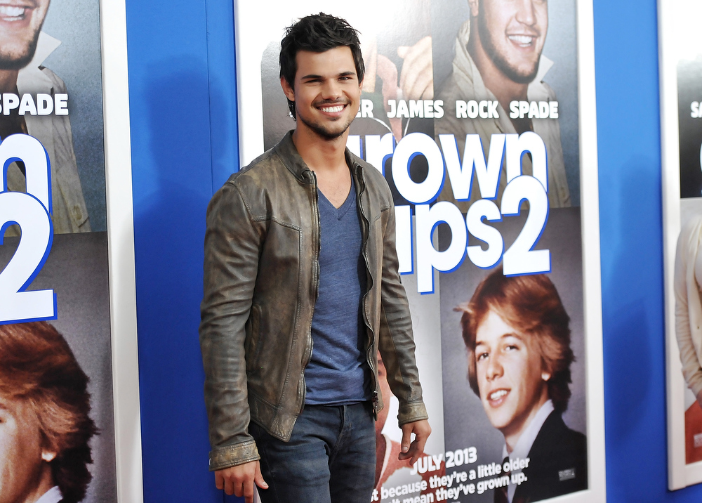". Actor Taylor Lautner attends the premiere of ""Grown Ups 2\"" at the AMC Loews Lincoln Square on Wednesday, July 10, 2013 in New York. (Photo by Evan Agostini/Invision/AP)"