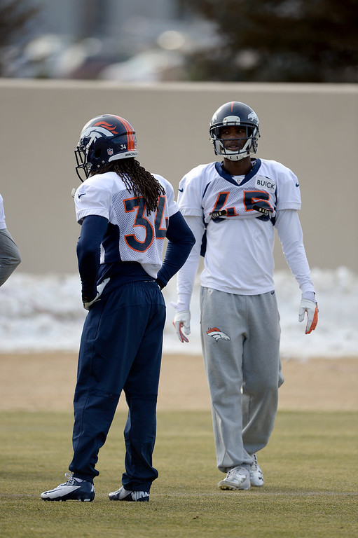. Denver Broncos cornerback Dominique Rodgers-Cromartie (45) and Denver Broncos cornerback Marquice Cole (34) run through drills during practice January 15, 2014 at Dove Valley. The Broncos are preparing for their game against the New England Patriots in the AFC championship game. (Photo by John Leyba/The Denver Post)