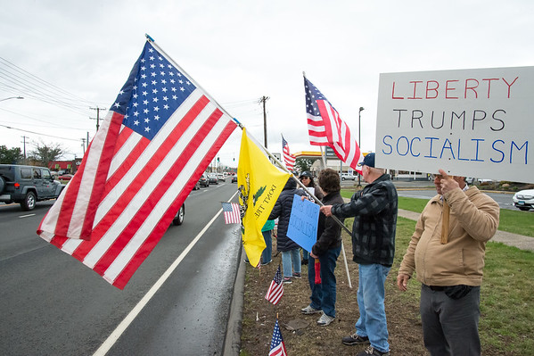 04/15/19 Wesley Bunnell | Staff Local TEA Party members protested taxes on Queen St. in Southington on April 15th which is the federal deadline for filing taxes. American flags and signs denouncing socialism were held by the protestors.