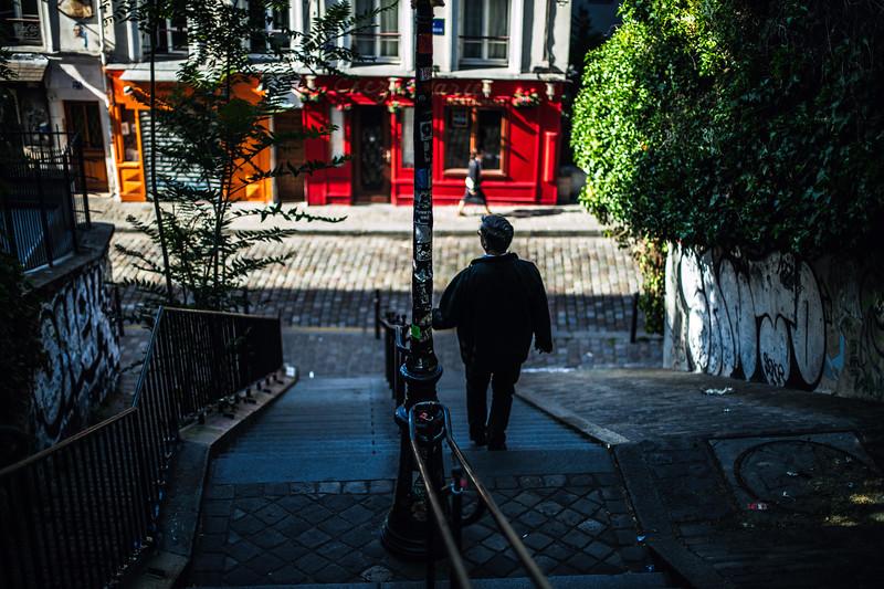 paris stairs down man walking colorful.jpg
