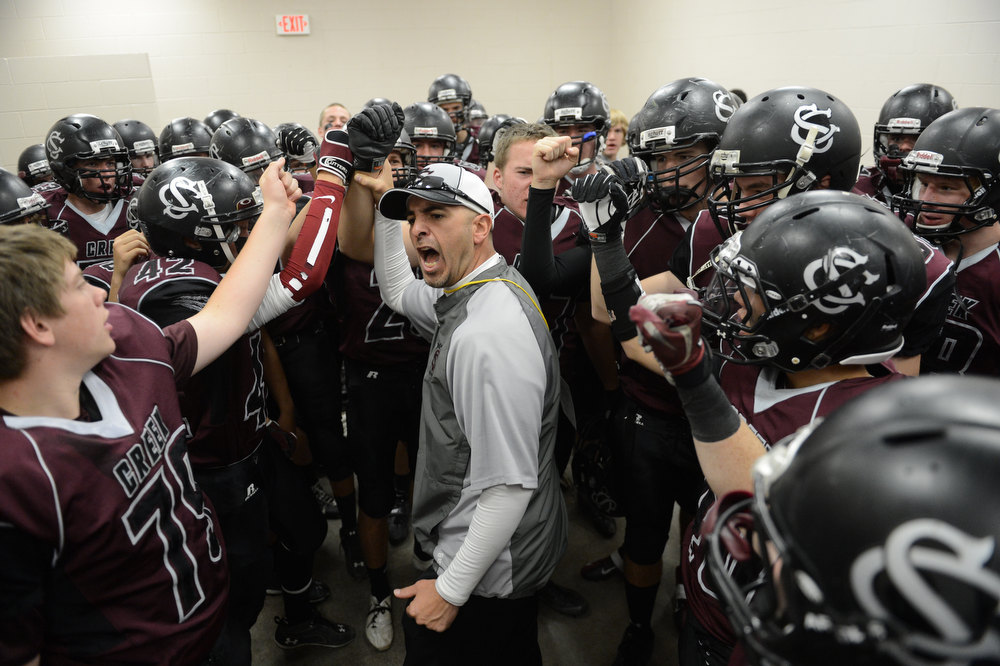 . Silver Creek Head Coach Mike Apodaca encourages his team during halftime of the Class 3A Championship football game, Saturday December 01, 2012.  The Silver Creek Raptors beat  the Rifle Bears 32 - 15 at Legacy Stadium in Aurora, CO. Craig F. Walker, The Denver Post