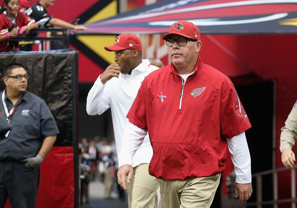 . Head coach Bruce Arians of the Arizona Cardinals walks out onto the field before the NFL game against the Carolina Panthers at the University of Phoenix Stadium on October 6, 2013 in Glendale, Arizona.  (Photo by Christian Petersen/Getty Images)