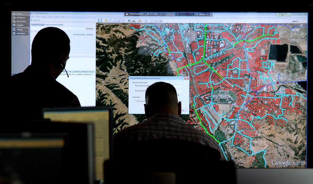 . Workers look over a map on one of the Smart Boards at the PG&E natural gas system regional primary control center in San Ramon, Calif., on Thursday, Aug. 5, 2013. The new facility controls the service area that stretches from Bakersfield to Eureka. (Dan Honda/Bay Area News Group)