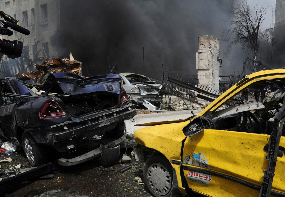 Description of . A view shows wreckage of cars,after a suicide car bomb exploded in the main business district of Damascus April 8, 2013, in this handout photograph distributed by Syria\'s national news agency SANA .The death toll from a suicide car bomb which exploded in central Damascus on Monday rose to 15, with 47 wounded, Syrian state television said. REUTERS/SANA/Handout